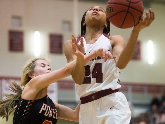 Oak Ridge's Jada Guinn (24) goes up for a shot as Powell's Savanna Parker (5) defends her during a high school basketball game between Powell and Oak Ridge at Powell Thursday, Jan.  25, 2018.