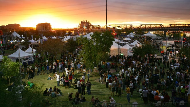 The scene at the annual Four Peaks Oktoberfest at Tempe Beach Park.  The event features polka bands, family-friendly entertainment, carnival rides and plenty of beer.