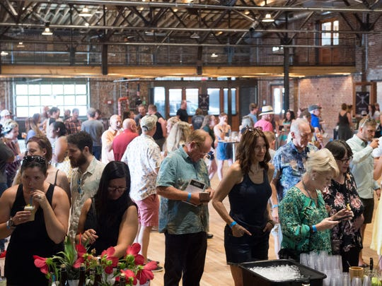 Hundreds of people attend Brewtails at the Mill & Mine on Sunday, September 24, 2017. The event was to showcase unique drinks designed by 16 teams pairing craft breweries and mixologists from cocktail bars, restaurants and distilleries.
