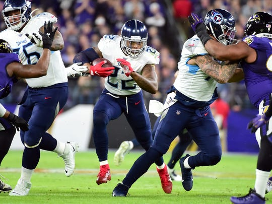 Jan 11, 2020; Baltimore, Maryland, USA; Tennessee Titans running back Derrick Henry (22) runs with the ball in the first quarter against the Baltimore Ravens in a AFC Divisional Round playoff football game at M&T Bank Stadium. Mandatory Credit: Evan Habeeb-USA TODAY Sports
