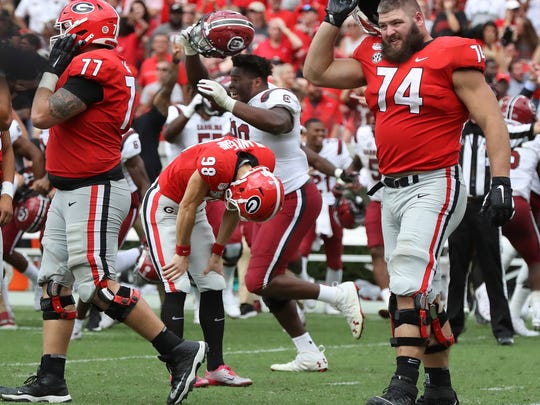 Georgia kicker Rodrigo Blankenship (98) reacts after missing field goal attempt in double over time as South Carolina celebrates a 20-17 win on Saturday, Oct., 12, 2019, in Athens, Ga.