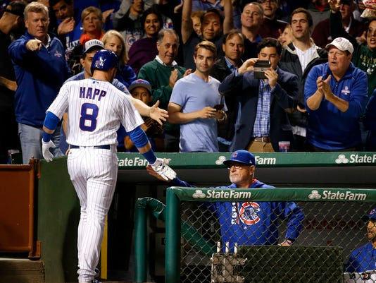 Chicago Cubs' Ian Happ (8) celebrates his home run with manager Joe Maddon at the dugout during the eighth inning of the team's baseball game against the San Diego Padres on Tuesday, June 20, 2017, in Chicago. (AP Photo/Charles Rex Arbogast)