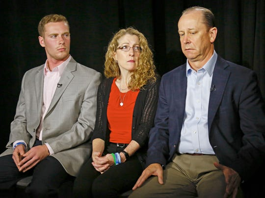 FILE – In this May 15, 2017, file photo, James Piazza, right, seated with his wife Evelyn, center, and son Michael, left, holds back emotions while discussing the death of his son, Penn State University fraternity pledge Tim Piazza, during an interview in New York. Members of Penn State University's now-shuttered Beta Theta Pi fraternity chapter are due in court Monday, June 12, 2017, for a hearing on charges related to the Feb. 4, 2017, death of 19-year-old Tim Piazza, of Lebanon, N.J., after a night of heavy drinking. (AP Photo/Bebeto Matthews, File)
