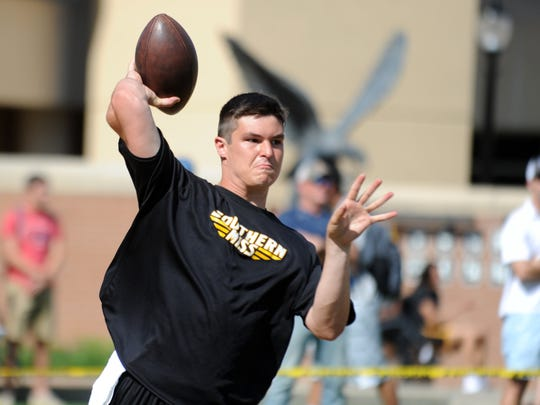Southern Miss quarterback Nick Mullens throws a pass at Pro Day in M.M. Roberts Stadium on Tuesday.