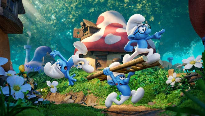 Clumsy (voiced by Jack McBrayer), Hefty (Joe Manganiello, center) and Brainy (Danny Pudi, with glasses) in 'Smurfs: The Lost Village,' which arrives in theaters March 31, 2017.