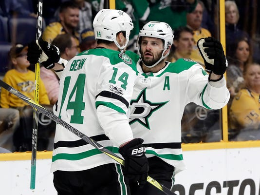 Dallas Stars left wing Jamie Benn (14) is congratulated by Alexander Radulov (47), of Russia, after scoring a goal against the Nashville Predators in the first period of an NHL hockey game Thursday, Oct. 12, 2017, in Nashville, Tenn. (AP Photo/Mark Humphrey)