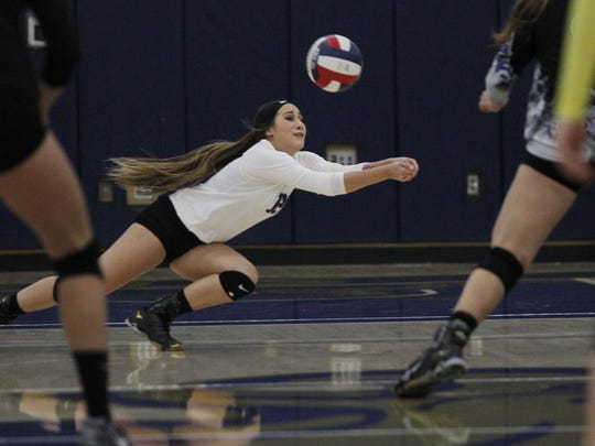 Mission Oak's Alyssa Parkison digs one out against Bakersfield Christian during a Central Section Division III championship volleyball game held in Lemoore, Calif., Saturday, Nov. 12, 2016 in the Golden Eagle Arena at West Hills College.