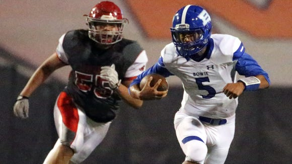Bowie quarterback German Carrasco finds running room against Jefferson Thursday night in the Sun Bowl.