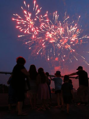 Spectators watch fireworks at Freehold Raceway in July 2016.