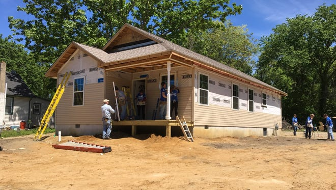 Gloucester County Habitat for Humanity works on a Tanyard Road house in Deptford for Rosa Pineiro, a single mom and Marine veteran, during National Women Build Week.