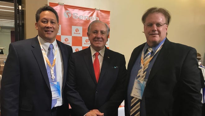 Guam Volleyball Federation President Herman Ada, left, with the FIVB President Dr. Ary S. Graça, center, and Terry Sasser, right, the Western Zone Vice President for OZVA at the 22nd Asian Volleyball Confederation General Assembly.
