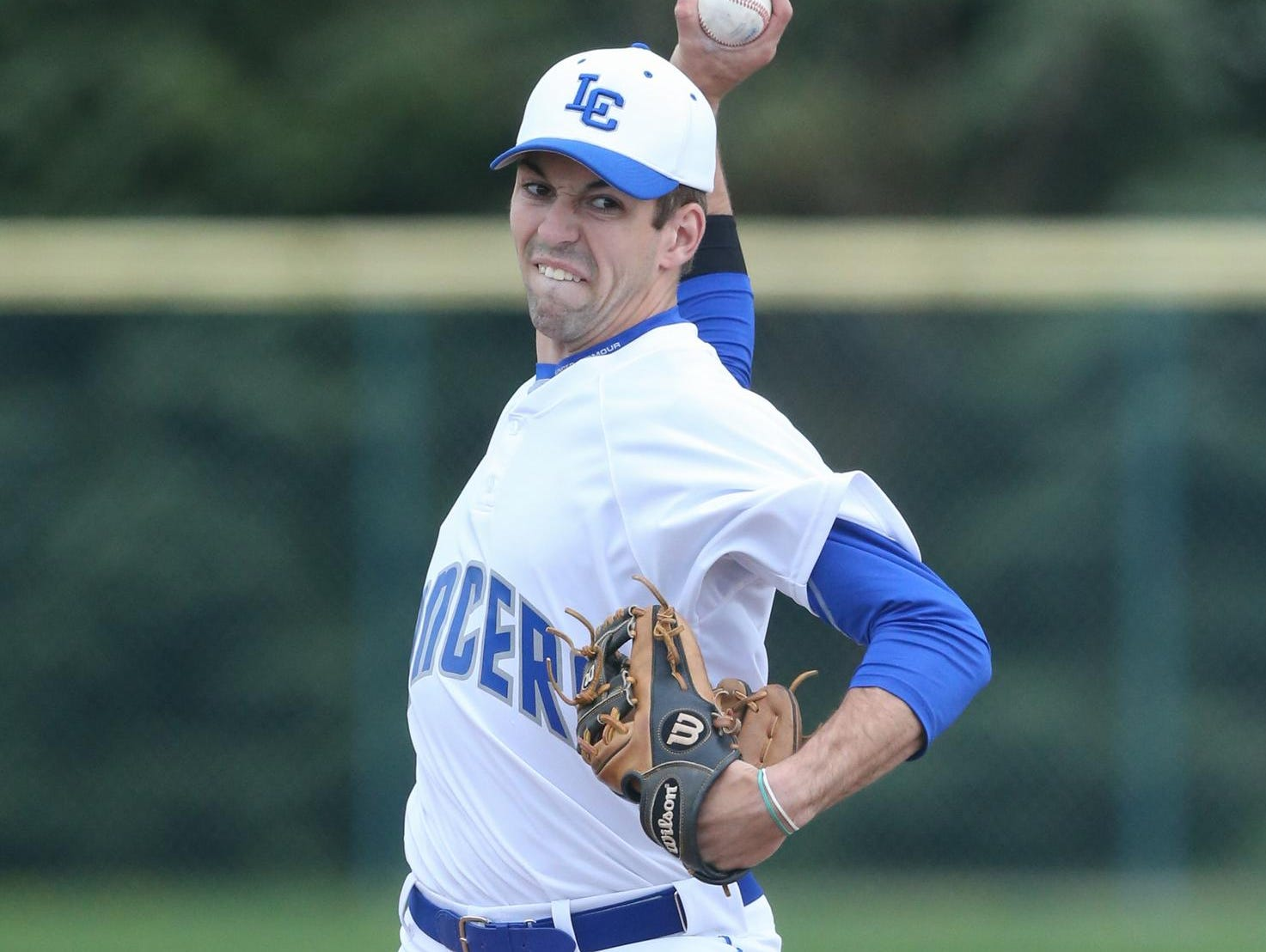 L'Anse Creuse High School's Jeremy Spezia pitches against visiting Romeo on Monday. Spezia struck out seven and gave up just two hits in the 6-0 victory. He also drove in two runs.
