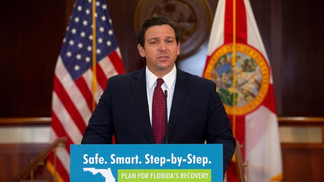 Gov. Ron DeSantis holds a news conference in the cabinet room of the Capitol after signing the state budget Monday, June 29, 2020.