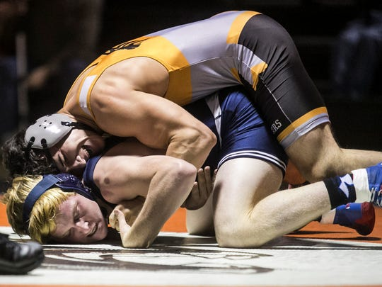 Central York's Antonio Rivera wrestles Dallastown's