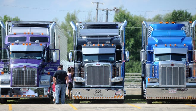 Spectators view trucks at the 25th Annual Waupun Truck-n-Show. Truckers from around the country gather to show off their rigs in a salute to the trucking industry.