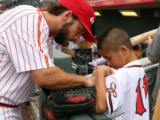 Anthonie Martinez get his jersey signed Aug. 1 by Forrest Allday, El Paso Chihuahuas center fielder.