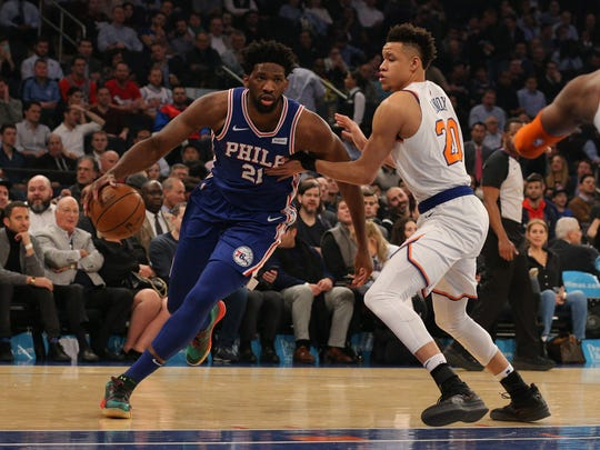 Philadelphia 76ers center Joel Embiid (21) drives against New York Knicks forward Kevin Knox (20) during the first quarter at Madison Square Garden.