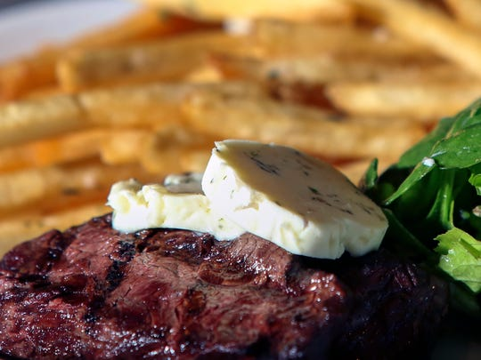 The Steak Frites, a hanger steak with shallot tarragon butter, french fries and mesclun salad, from Brasserie Provence.