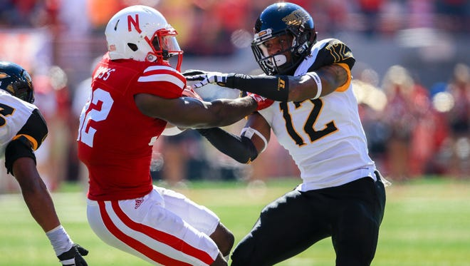 Southern Miss safety D'Nerius Antoine brings down Nebraska's Imani Cross during a game earlier this season.