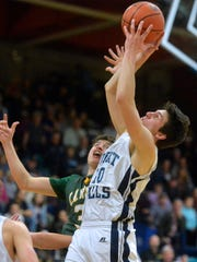 Great Falls High's Blake Thelen grabs a rebound.