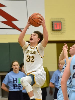 CMR's Bryce Depping attempts a layup.