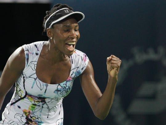 Venus Williams of the U.S. celebrates after she beats Alize Cornet of France during the final match of Dubai Duty Free Tennis Championships in Dubai, United Arab Emirates, Saturday, Feb. 22, 2014. (AP Photo/Kamran Jebreili)