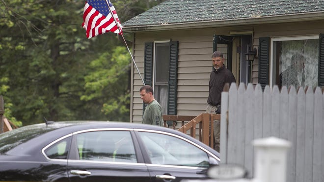 Law enforcement exits a house Thursday on Division Street in Bancroft. Division Street was blocked off while law enforcement investigate the scene, where Larry Sanchez, 55, allegedly shot and killed his wife, Lisa Sanchez, 47, on Wednesday.