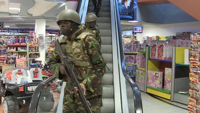 Kenyan soldiers take position inside a shopping mall after an attack by masked gunmen in Nairobi on Saturday.