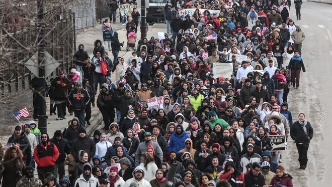 "Hundreds of people march along W. Vernor Hwy. in Detroit on Thursday February 16, 2017 after the ""Day Without Immigrants"" rally at Clark Park in southwest Detroit."