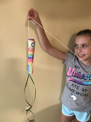 Mendon Public Library distributes 350 Take-and-Make crafts over the summer, including fish flags.