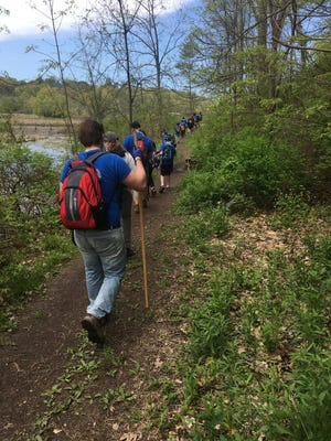 Troop 37 Scouts go on a hike in Lucien Morin Park.