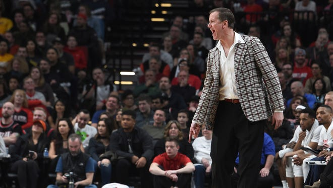Wearing a plaid blazer in honor of former Portland Trail Blazers coach Jack Ramsay, Blazers coach Terry Stotts yells out to his team during the second half of an NBA basketball game against the Los Angeles Lakers in Portland, Ore., Wednesday, Jan. 25, 2017. The Blazers won 105-98.