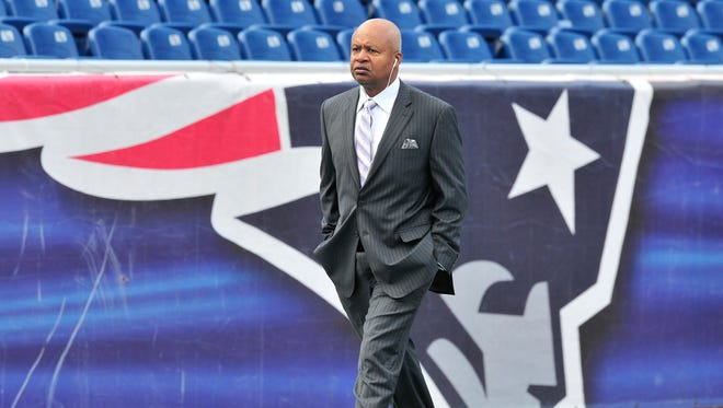 Lions head coach Jim Caldwell walks the field early Sunday morning, before the game against the Patriots.