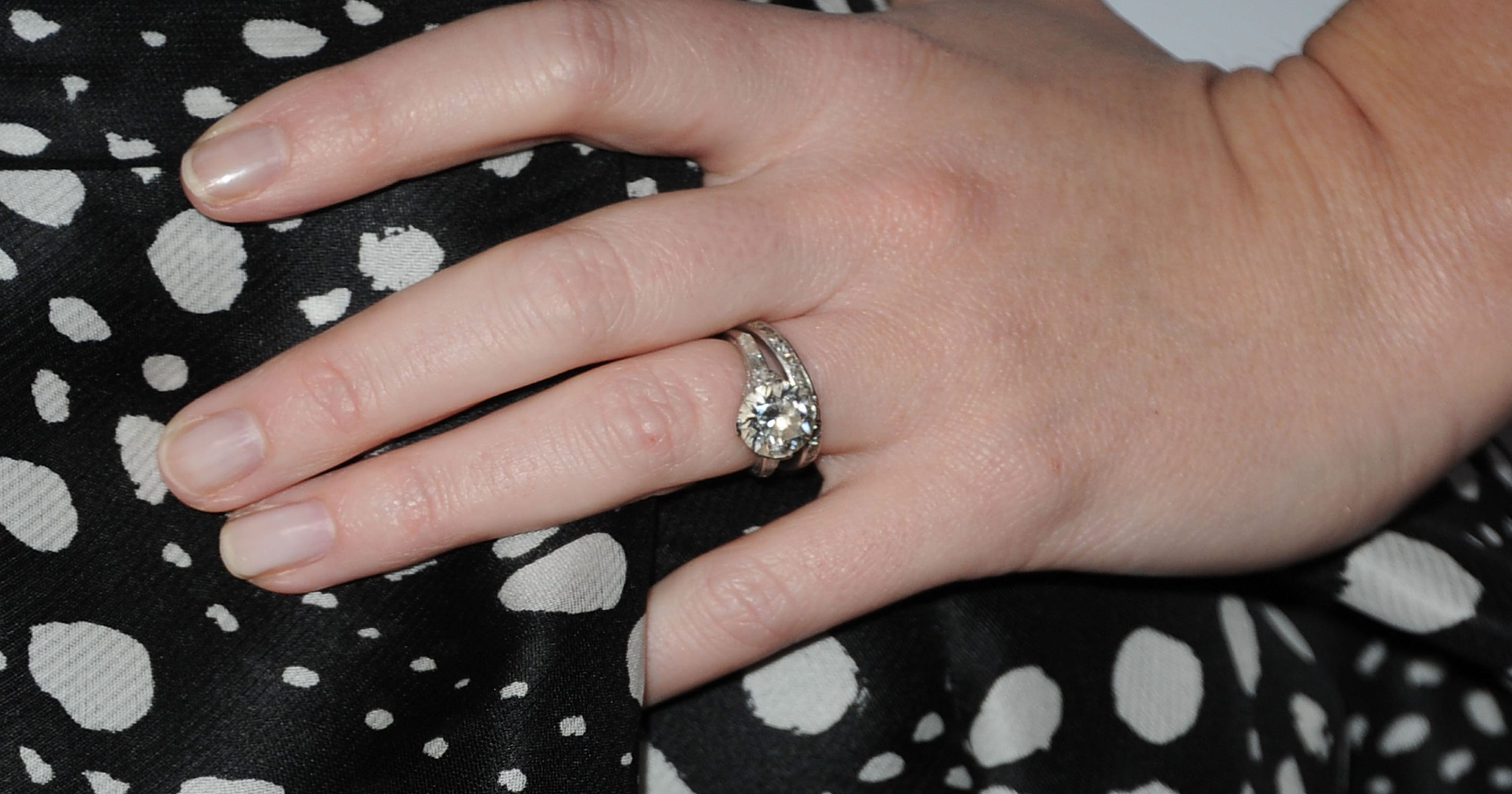 Engagement ring goes on the outside, mom-in-law
