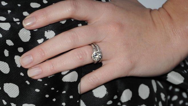 Actress Emily Blunt showing off proper wedding-ring/engagement-ring arrangement.