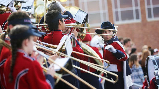 The South Salem Marching Band performs during a home game against McMinnville.