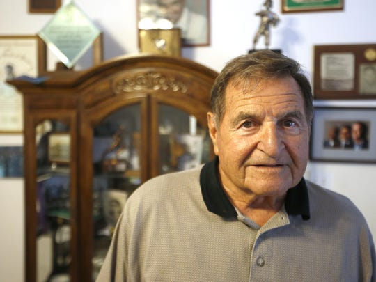 Former Florida State football coach Darrell Mudra stands in his Crawfordville home.