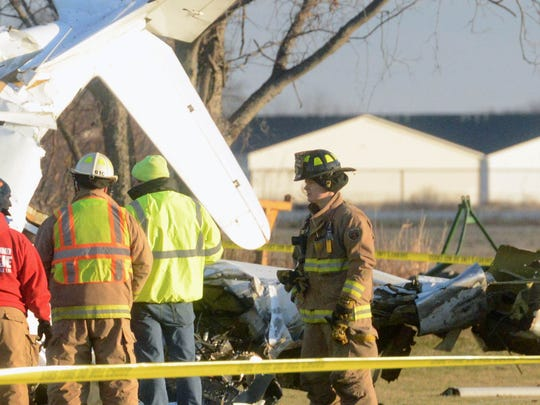 Crews tend to the scene after a plane crashed shortly after takeoff from the Erie Ottawa International Airport on Monday, Dec 29, 2014.