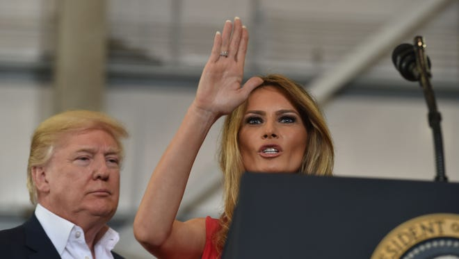 US President Donald Trump and First Lady Melania Trump arrive for a rally on February 18, 2017 in Melbourne, Florida.