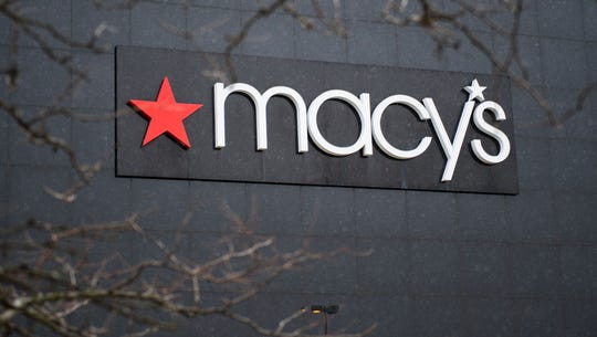 Macy's names new president, cuts about 100 jobs