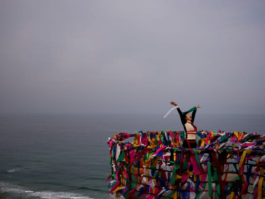 "Artist Doyu, 48, performs at the Goseong Unification Observatory as part of an art festival in Goseong, South Korea, Monday, Feb. 19, 2018. ""I'd like to express a bird who wants to fly wherever it wants without having any boundary,"" said the performer. Located just south of the DMZ, the observatory is one of northernmost points in South Korea where civilians can travel to have a glimpse into North Korea. (AP Photo/Jae C. Hong)"