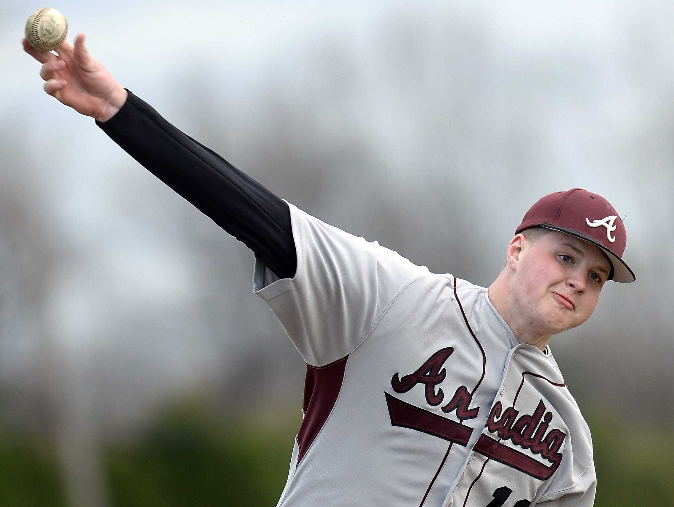 Greece Arcadia's Gannon MacNeal releases a pitch during Friday's game.