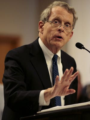"""Ohio State Attorney General Mike DeWine addresses the media in a press conference in Piketown, Ohio, on Friday, April 22, 2016. Officials arrived to multiple homes on Union Hill where eight members of the Rhoden family were found dead, victim of gun shot wounds in what was described as """"execution style"""" shootings."""