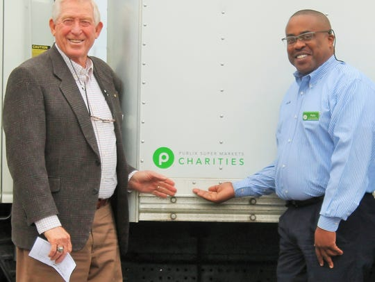 Standing in front of a new box truck funded by Publix