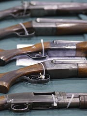 Shot guns on display at the Oregon State Fairgrounds in 2013.