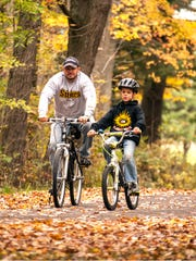 Keith Hambley and his son Drew, 9 of Churchville discover the joy of father and son time riding their bikes in Churchville Park.