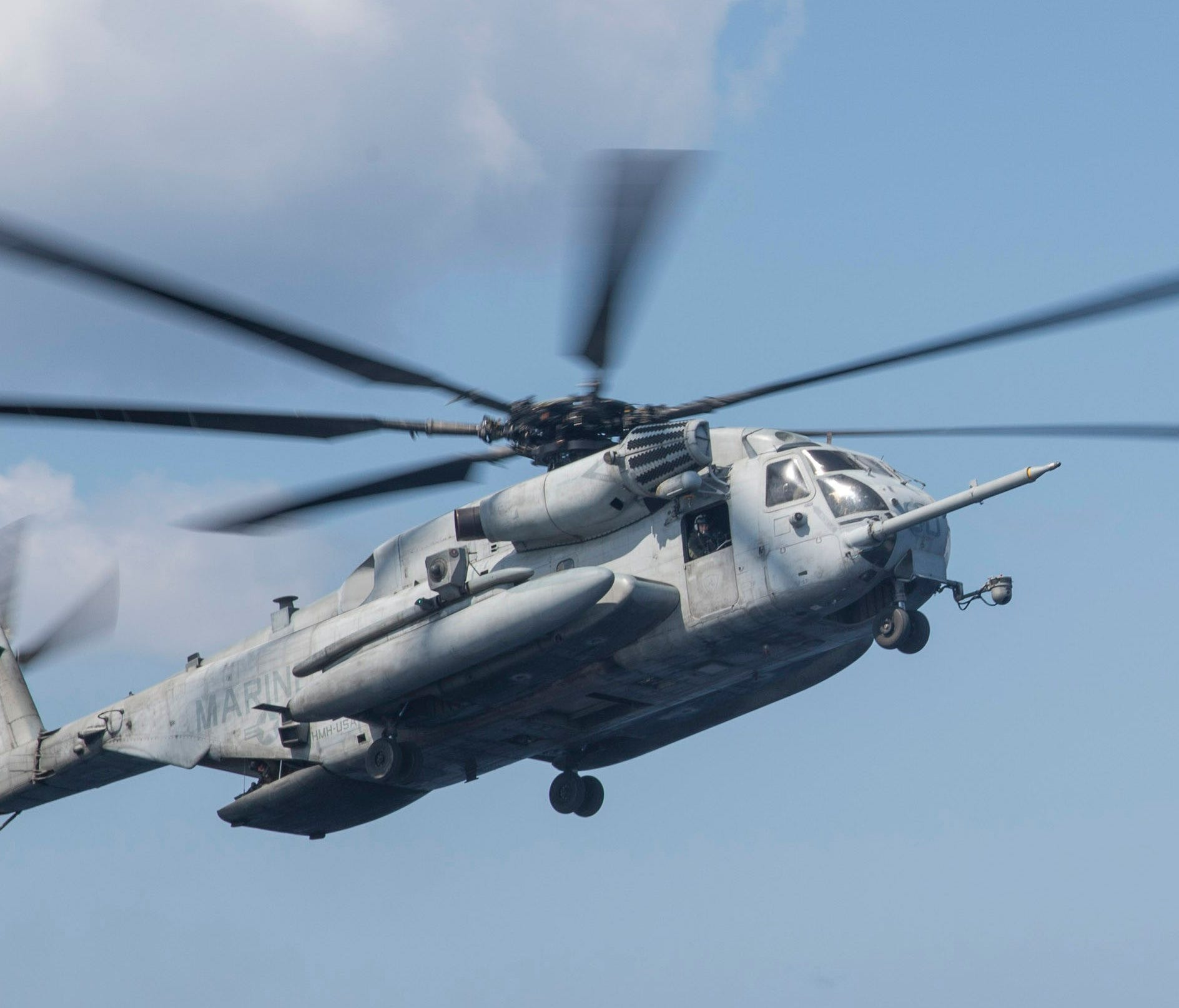A handout photo made available by the US Navy shows a CH-53 Super Stallion, assigned to the 'Wolfpack' of Marine Heavy Helicopter Squadron (HMH) 466, approaching the flight deck of the amphibious assault ship USS Bonhomme Richard (LHD 6) in the Phili