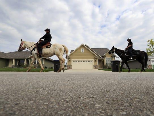 Green Bay Police Mounted Patrol officers Paul Vanhandel