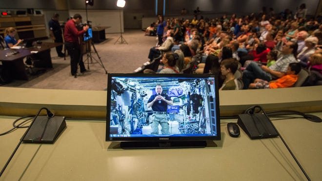 Ricky Arnold, a NASA astronaut on the International Space Station, speaks with children from Las Cruces Public Schools, who brought questions to ask Arnold during the NASA Downlink presentation Tuesday July 31, 2018, at Las Cruces City Hall.