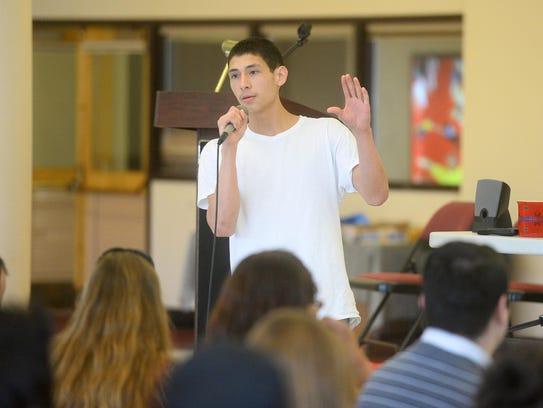 Trey'al Belgarde speaks to students at the Montana